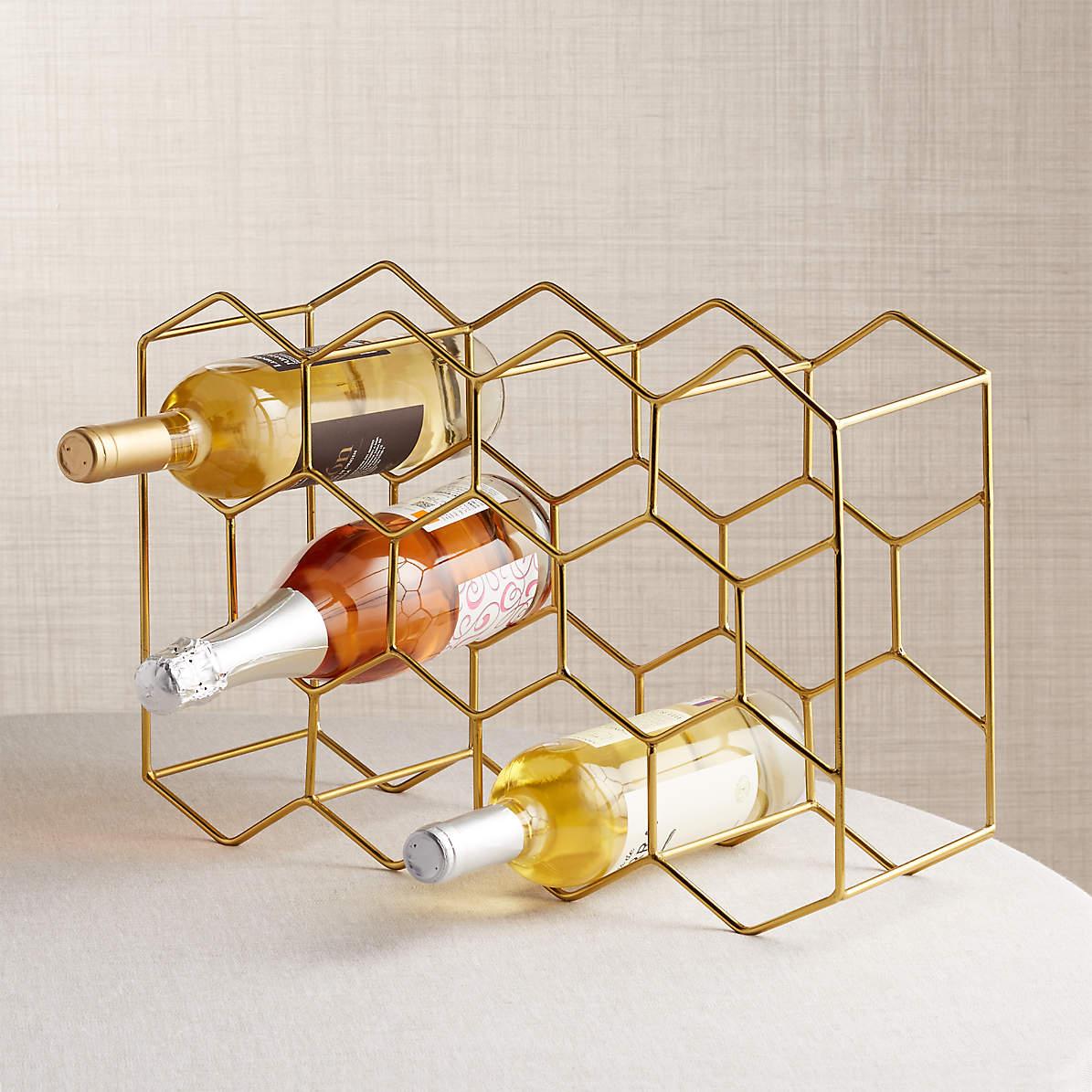 Girl inserts bottle 11 Bottle Gold Wine Rack Reviews Crate And Barrel