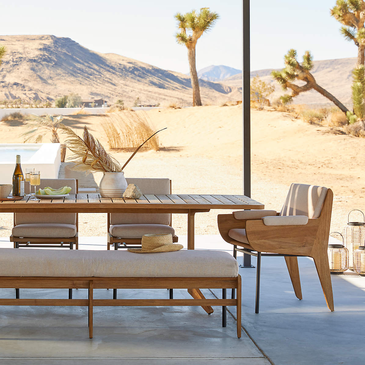 kinney teak outdoor dining table bench chair and armchair crate and barrel